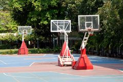 A red basketball hoop with white rope net. A red basketball hoop with white rope net on the children playground in the school stock photography