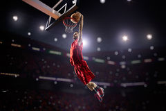 Red Basketball player in action. In gym Stock Images