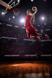 Red Basketball player in action. In gym Royalty Free Stock Images