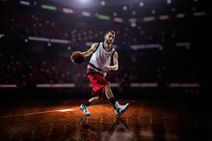 Red Basketball player in action Royalty Free Stock Photos
