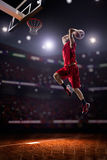 Red Basketball player in action Stock Images