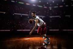 Red Basketball player in action. In gym Stock Photo