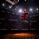 Red Basketball player in action. In gym Royalty Free Stock Photo