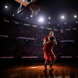 Red Basketball player in action stock photography