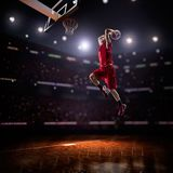Red Basketball player in action. In gym Stock Photography