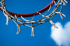 Red Basketball rim and white cloud Stock Image
