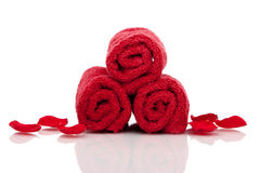 Red bath towels and rose petals Stock Photography