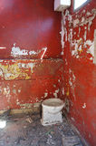 Red bathroom. Old red bathroom in an abandoned factory royalty free stock image