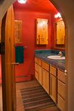 Red bathroom. Cute red bathroom with arched doorway Stock Photos