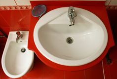 Red bathroom detail. A detail of a bathroom with mirror Royalty Free Stock Images