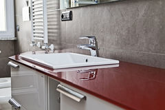 Red bathroom faucet reflection Royalty Free Stock Photo