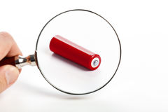 Red battery and magnifying glass Stock Photo