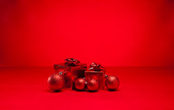 Red bauble and Christmas present Royalty Free Stock Photo
