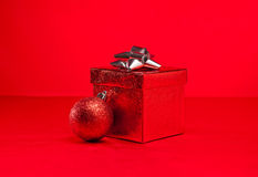 Red bauble and Christmas present Stock Image