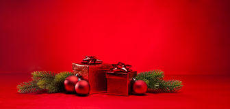 Red bauble and Christmas present Royalty Free Stock Images