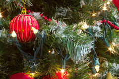 Red bauble christmas tree garland and lights Royalty Free Stock Photos