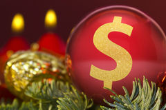 Red bauble with the golden shape of a Dollar symbol. series Stock Photography