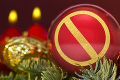 Red bauble with the golden shape of a forbidden symbol. series Stock Photo