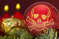 Red bauble with the golden shape of a skull. series Stock Photography