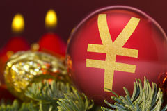 Red bauble with the golden shape of a Yen symbol. series. A glossy red bauble with the golden shape of a Yen symbol.series royalty free stock photography
