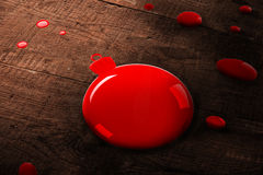 A red bauble paint splash Stock Photography