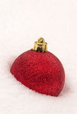 Red Bauble in Snow Stock Photography