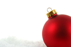 Red Bauble in the Snow Upclose Royalty Free Stock Photography