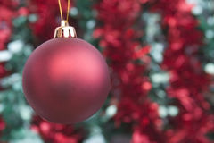 Red bauble and tinsel Stock Photos