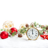 Red baubles and antique golden clock in snow on white Royalty Free Stock Images