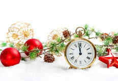 Red baubles and antique golden clock in snow on white Stock Images