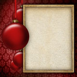Red baubles and blank sheet in picture frame. Red baubles and blank paper sheet in picture frame Royalty Free Stock Images