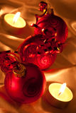 Red Baubles in candle light Royalty Free Stock Photos