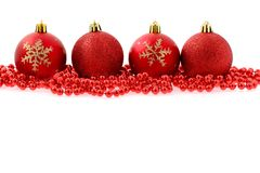 Red baubles Christmas background. Red baubles isolated on white Christmas background royalty free stock photos