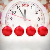 Composite image of red baubles christmas decoration. Red baubles christmas decoration against glowing christmas background stock illustration