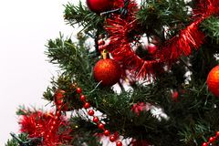 Red baubles on a Christmas tree. Red and shinny baubles on a Christmas tree with beautiful green branches. Merry Christmas Stock Images
