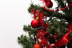 Red baubles on a Christmas tree. Red and shinny baubles on a Christmas tree with beautiful green branches. Merry Christmas Royalty Free Stock Image