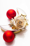 Red baubles and gift box, half-moon-shaped Royalty Free Stock Image