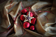 Red baubles and golden star christmas ornaments Stock Photo
