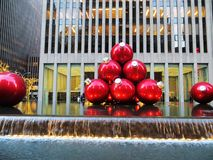 Red Baubles Near Grey High-rise Building royalty free stock image