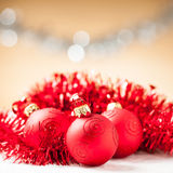 Red baubles with shiny tape in background Stock Photo