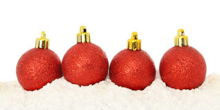 Red baubles on snow Royalty Free Stock Image