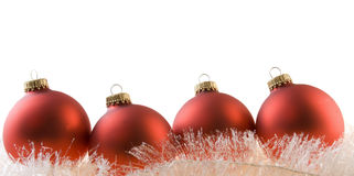 Red baubles on white garland Stock Images