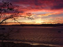 Red bay. Panoramic view of the bay on a red dawn stock photography