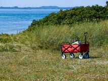 Red Beach Cart Trolley By The Sea Shore Royalty Free Stock Photography
