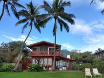Red Beach House in Waimanalo on a Beautiful Day Stock Photo