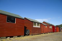 Red beach huts, blue sky Royalty Free Stock Photography