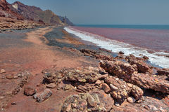 Red beach on iranian island of Hormuz, Hormozgan, Southern Iran. Red coast on the Iranian island of Hormoz, Hormozgan Province, Southern Iran Royalty Free Stock Image