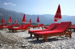 Red Beach loungers Stock Photos