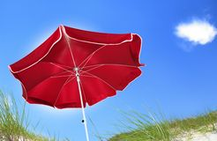 Red beach umbrella Stock Photos