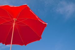 Red beach umbrella and blue sky Royalty Free Stock Image